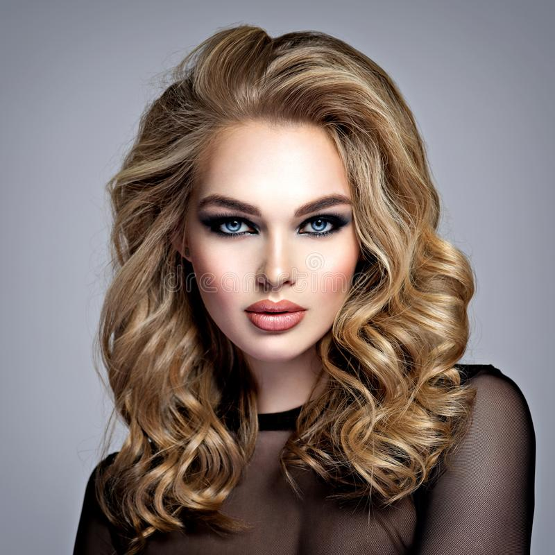 Beautiful blonde girl with  makeup in style smoky eyes royalty free stock photo