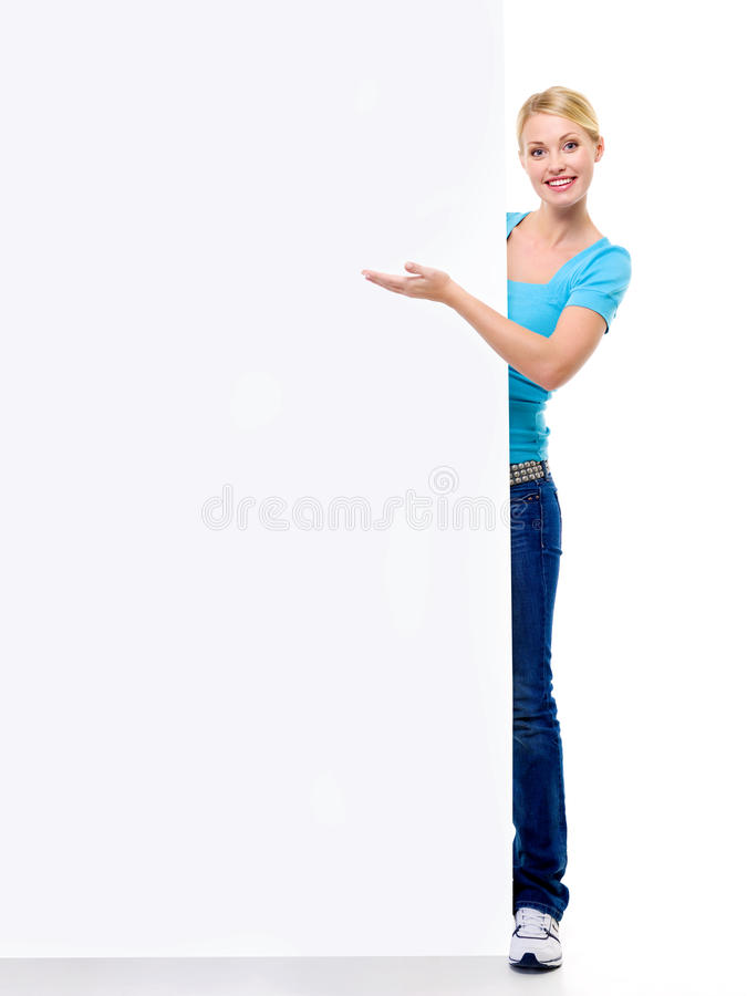 Download Beautiful Blonde Girl Points On The Billboard Stock Photo - Image of casual, empty: 12268608