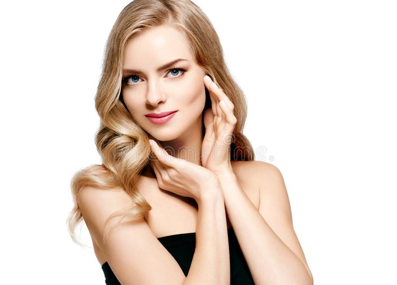 Beautiful blonde girl portrait, woman face with perfect curly hairstyle royalty free stock photos