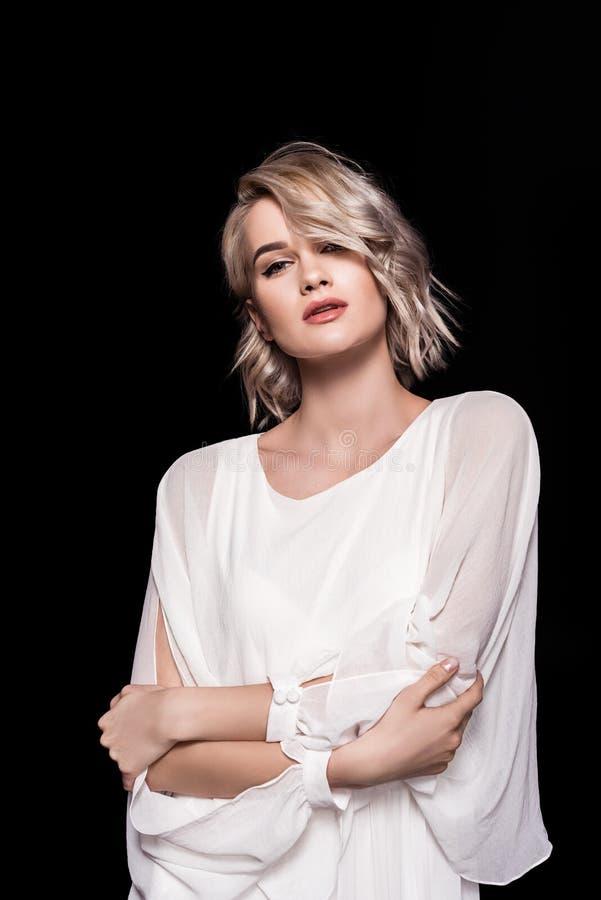 beautiful blonde girl posing in white dress, stock image