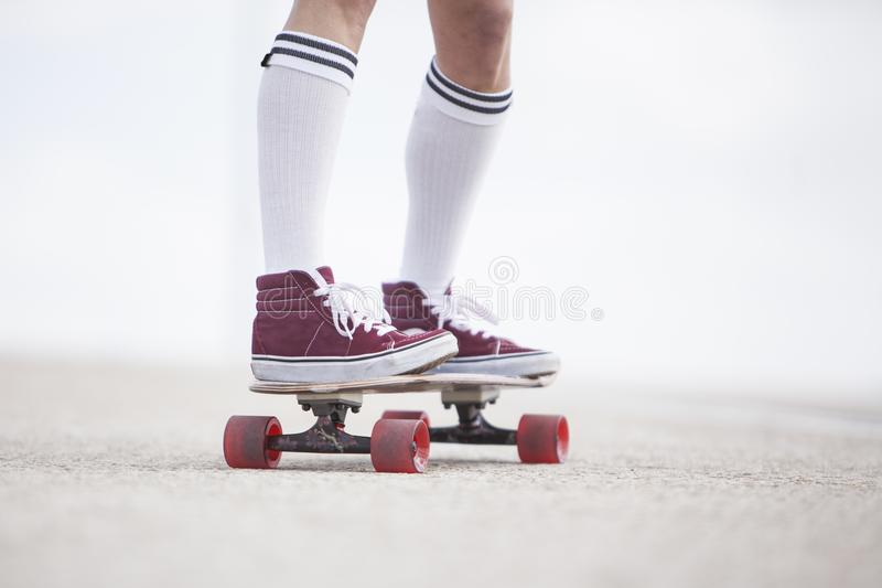 Girl rider long board royalty free stock image