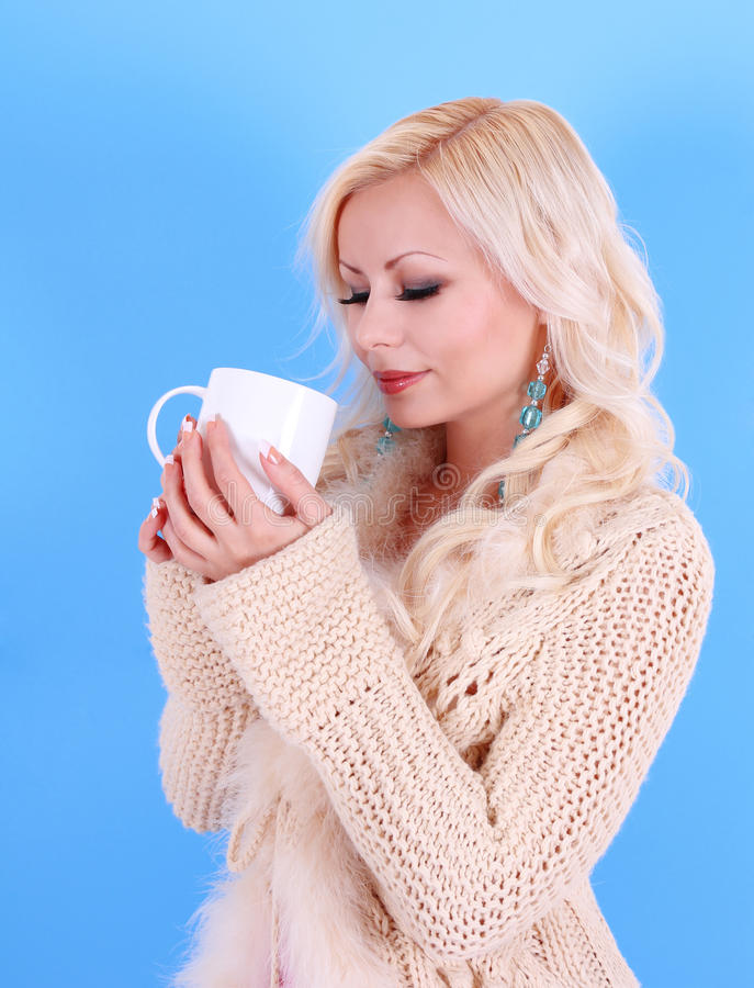 Download Beautiful Blonde Girl In Pullover With Cup Of Coffee, Over Blue Stock Photo - Image: 28108782
