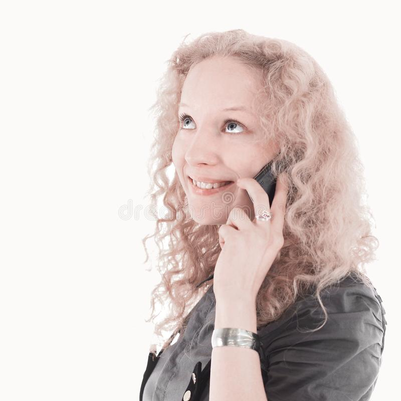 Beautiful blonde girl talking on the phone. Isolated on a white background. royalty free stock photo