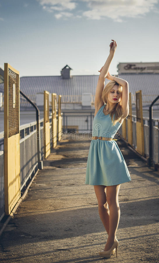 Beautiful blonde girl waiting for the train at the station. romantic, delicate look.  royalty free stock photo