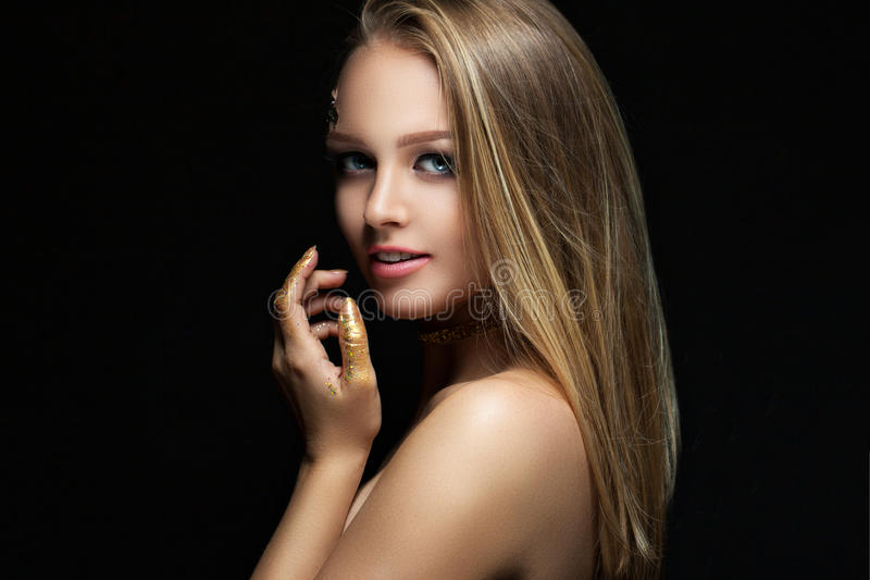 Beautiful blonde with golden make-up. Beauty fashion. Face close-up stock photography