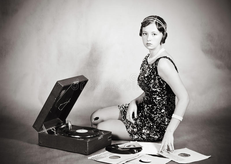 Beautiful blonde with a gramophone. The picture was taken in a home studio photographer stock image