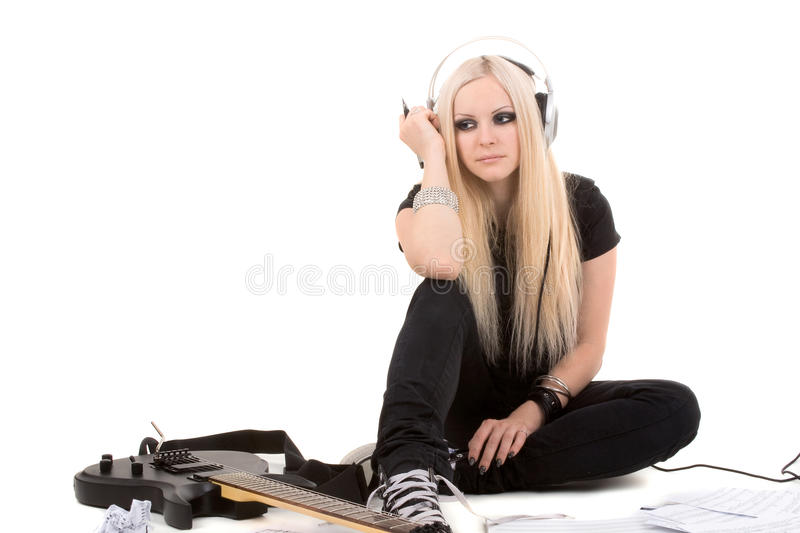 Beautiful blonde with a guitar stock photo