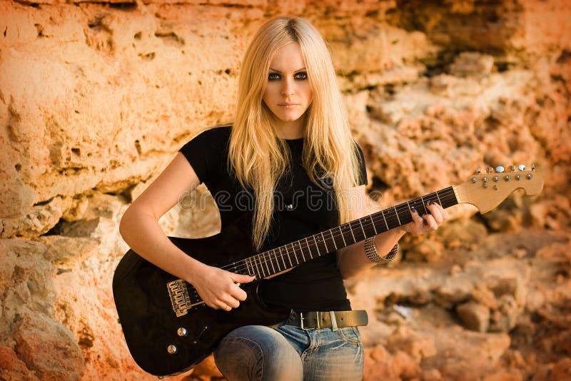 The beautiful blonde with a guitar stock photos