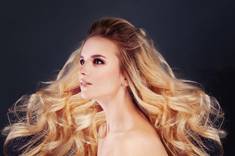 Beautiful Blonde Hair Woman with Permed Curly Hairstyle royalty free stock photos