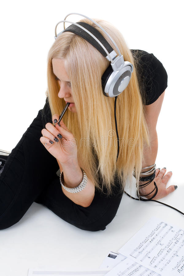 Beautiful blonde with a headphone royalty free stock photos