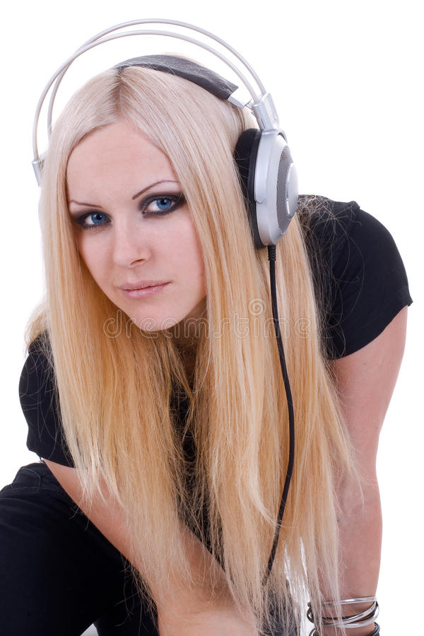 Beautiful blonde with a headphone royalty free stock images