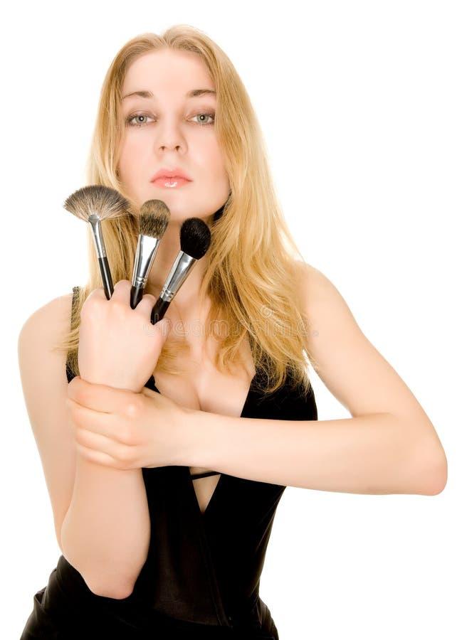 Download Beautiful Blonde Holding Brushes Stock Photo - Image: 12261258