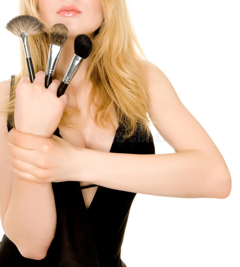 Beautiful Blonde Holding Brushes Stock Photography