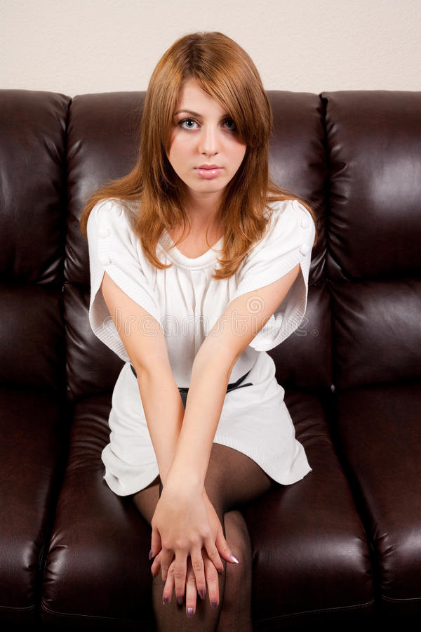 Beautiful Blonde On A Leather Couch Royalty Free Stock Images