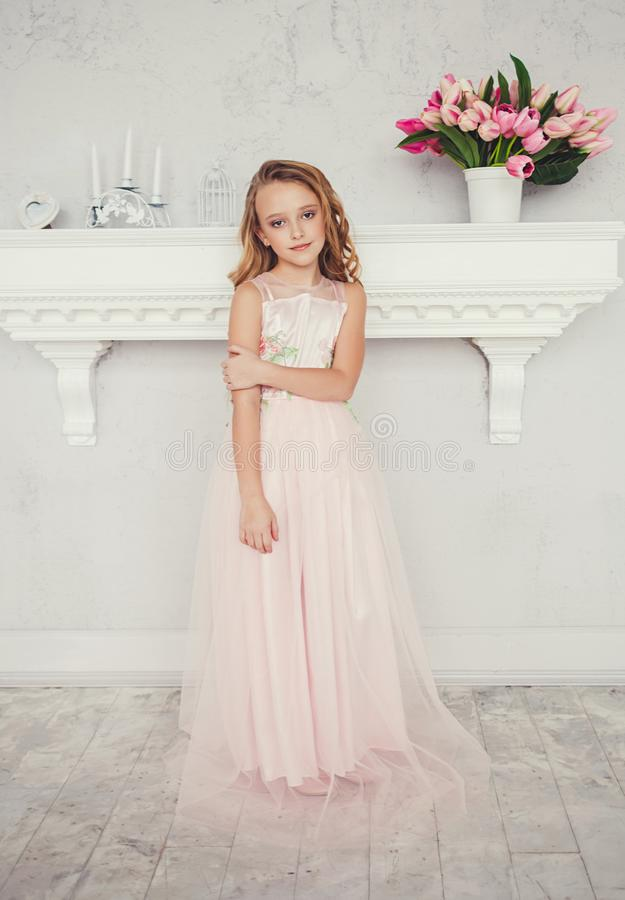 Beautiful blonde little girl in dress royalty free stock image