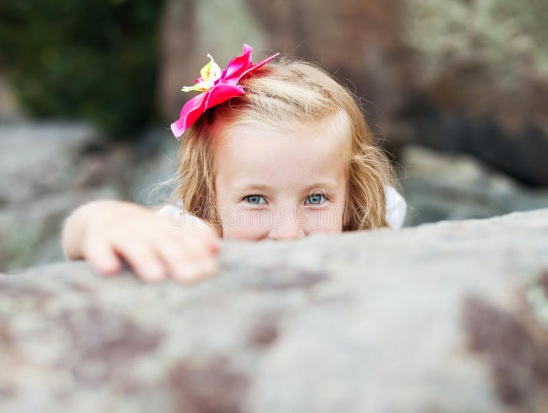 Download Beautiful Blonde Little Girl Hides Stock Image - Image: 21462947
