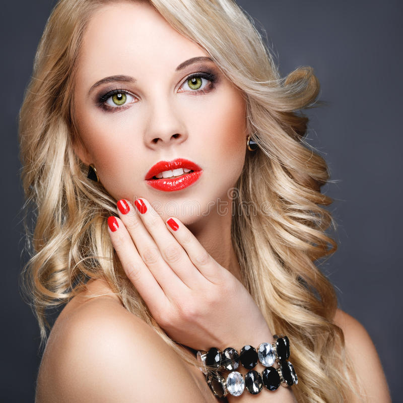 Beautiful blonde with long hair royalty free stock photography