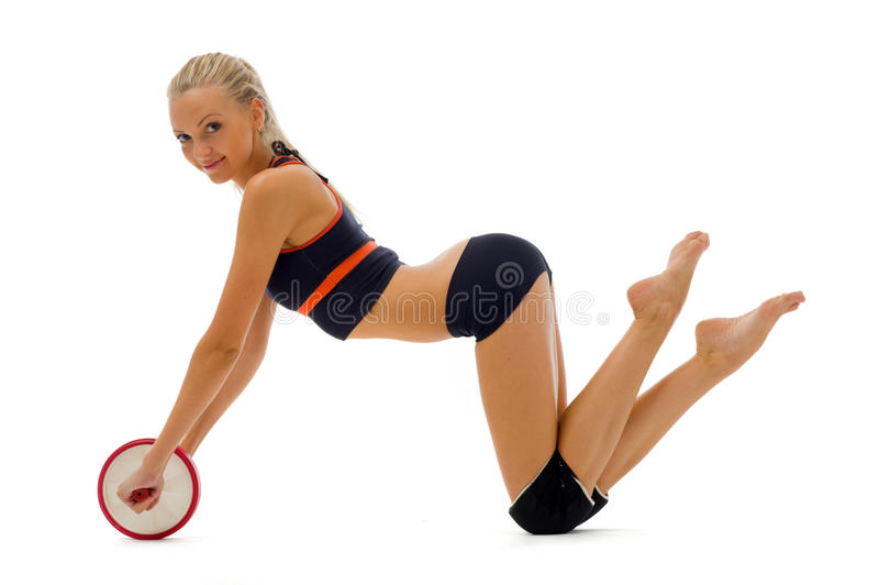 Beautiful Blonde Is Making Gym Exercises Royalty Free Stock Photography