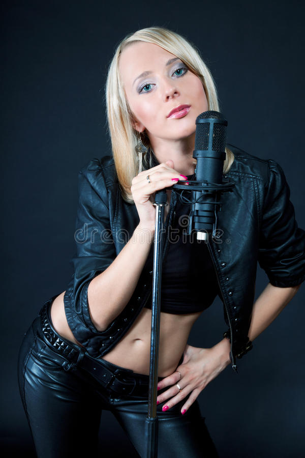 Beautiful Blonde With A Microphone Stock Photo - Image Of Equipment, Elegance 18418882-8205