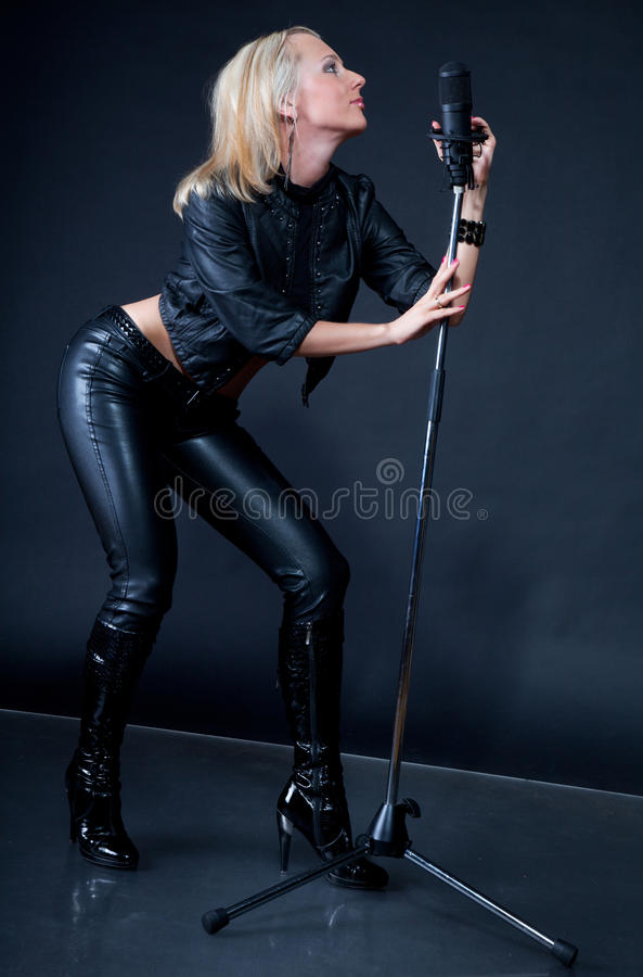Download Beautiful Blonde With A Microphone Stock Photo - Image: 16028994