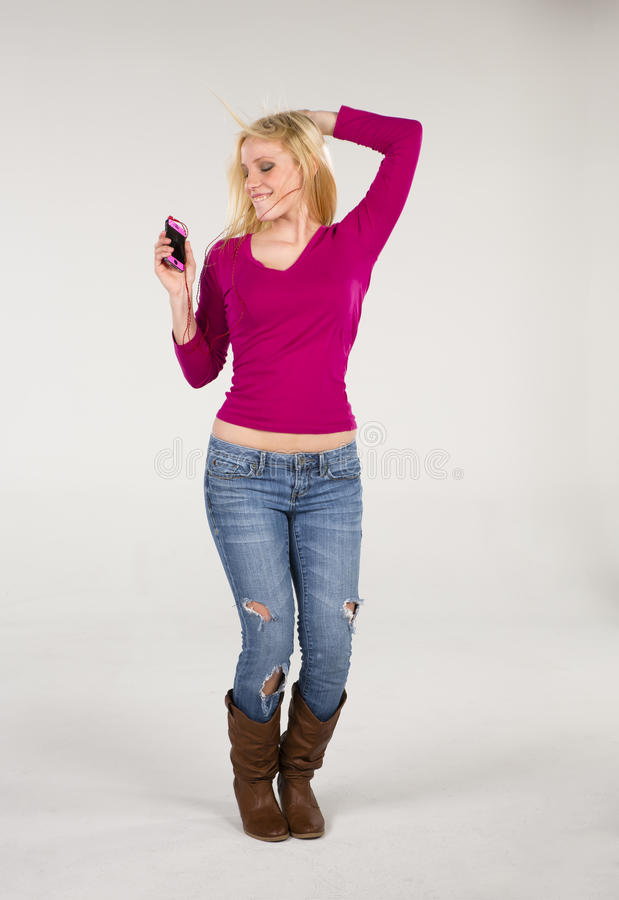 Beautiful Blonde Model Listen To Music royalty free stock image