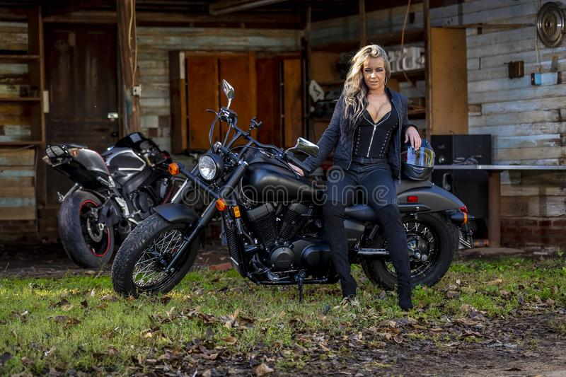 Beautiful Blonde Model Posing With A Street Motorcycle On A Sunny Day stock photography