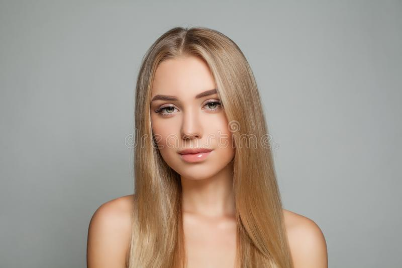 Beautiful blonde model woman with long healthy blonde hair royalty free stock images
