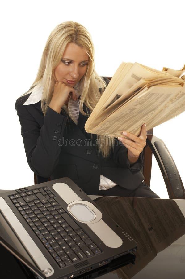 Beautiful Blonde Reading Newspaper royalty free stock photo