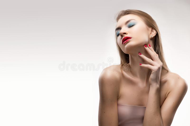 The beautiful blonde red lips closed eyes girl touches by finger royalty free stock photos