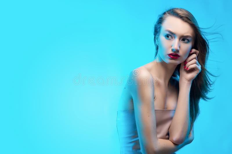 The beautiful blonde red lips girl touches by fingers face and a royalty free stock photos