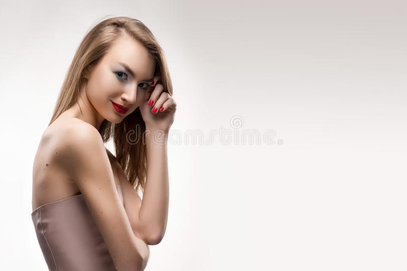 The beautiful blonde red lips smiling girl touches by fingers fa stock photos