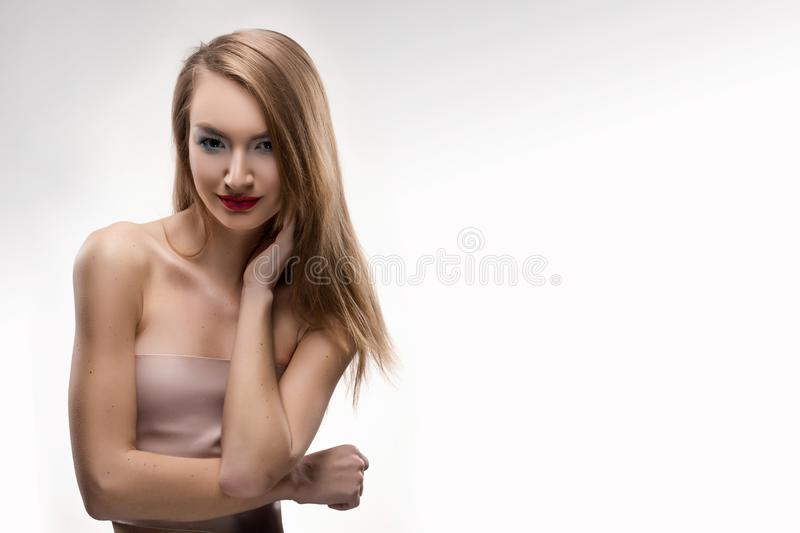 The beautiful blonde red lips smiling girl touches by fingers fa royalty free stock images
