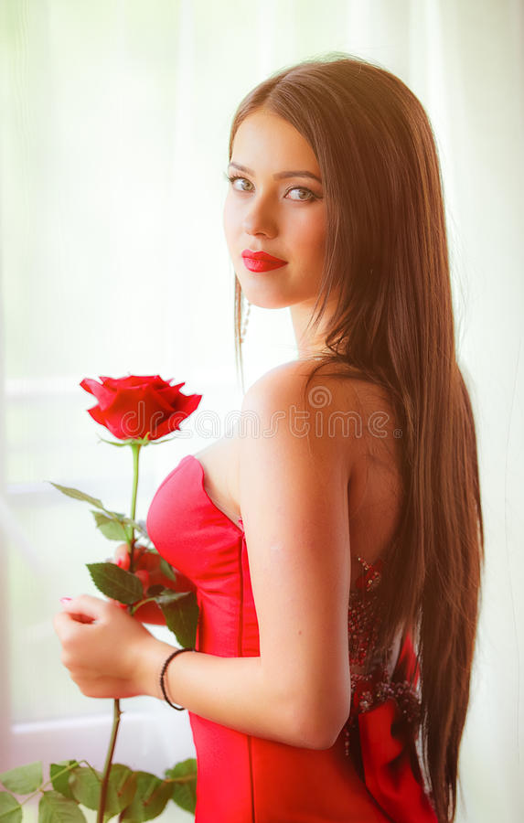 Beautiful blonde with red rose royalty free stock photography