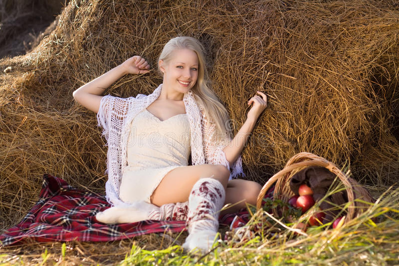 Download Beautiful Blonde Smiling Woman With Many Apple Stock Images - Image: 16741554