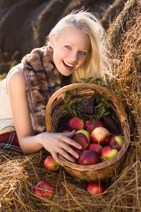 Download Beautiful Blonde Smiling Woman With Many Apple Stock Image - Image: 16741561