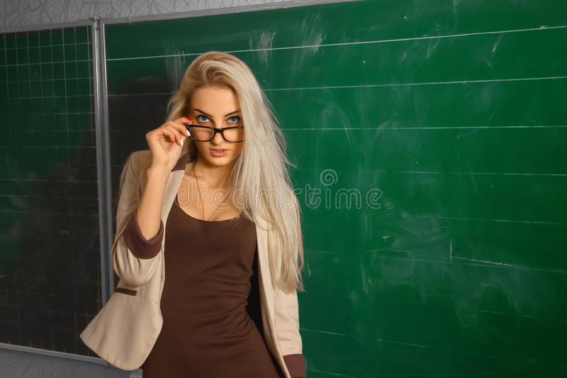 Beautiful Blonde Teacher At School Stock Image - Image 75930067-7855
