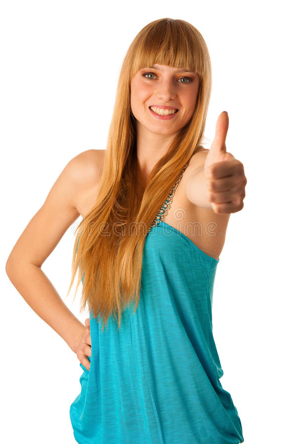 Beautiful blonde teenage girl showing thumb up as a sign of allright situation and success stock photography