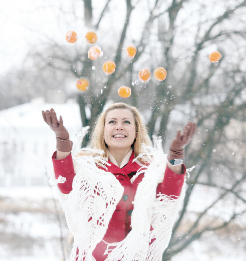 Beautiful blonde in a traditional Russian winter snow royalty free stock photography