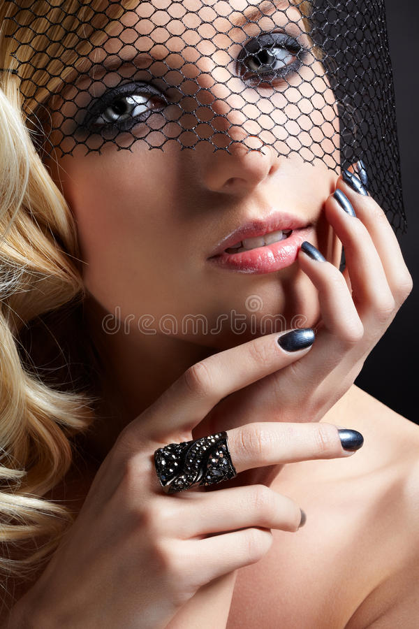 Beautiful blonde in veil royalty free stock photography
