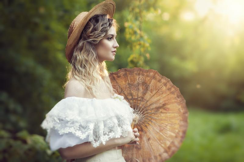 Beautiful blonde in a white vintage dress royalty free stock photography