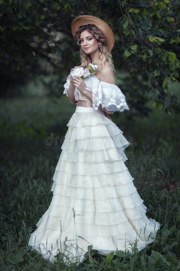 Beautiful blonde in a white vintage dress stock image