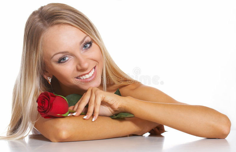 Beautiful Blonde Woman. A beautiful woman with a red rose royalty free stock photography