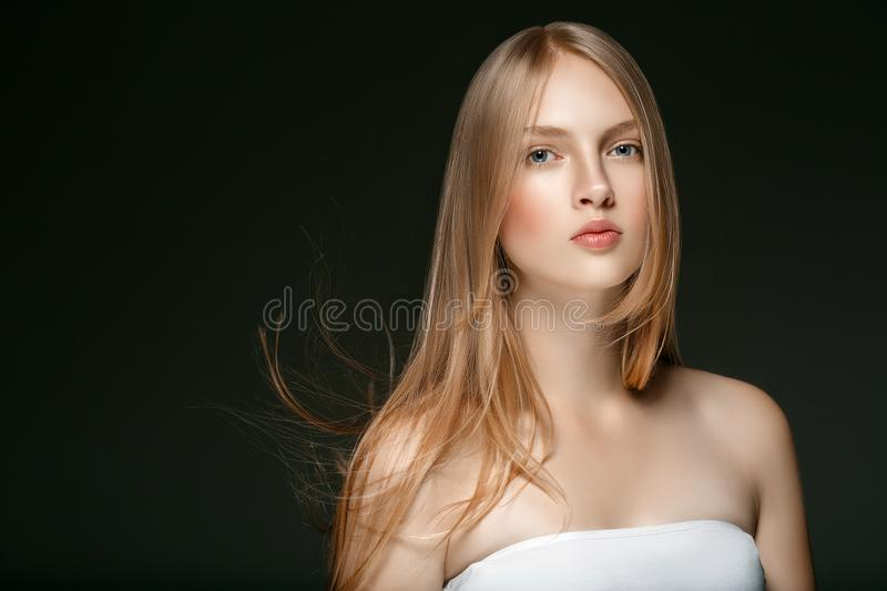 Beautiful Blonde Woman Beauty Model Girl with perfect makeup over black background. Beautiful Blonde Woman Beauty Model Girl with perfect makeup and hairstyle royalty free stock photos