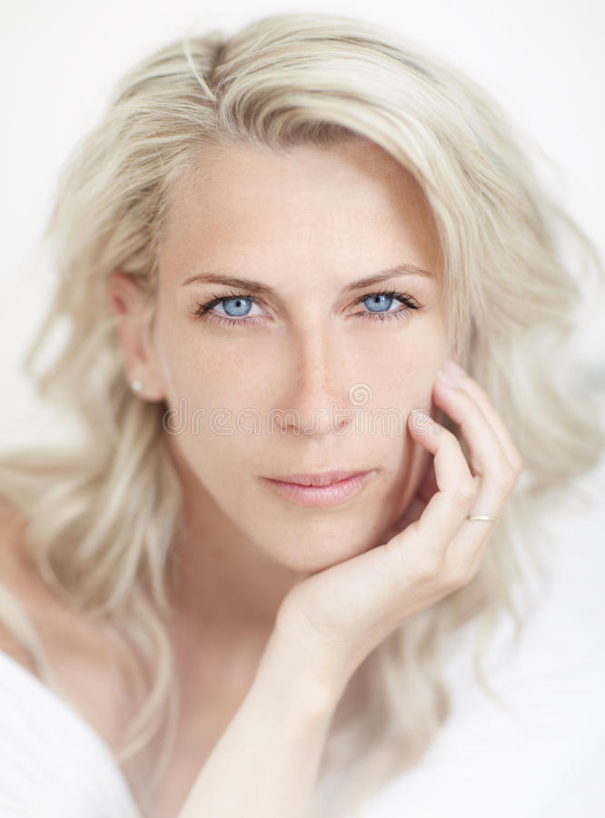 Beautiful blonde woman, blue eye, white bacground, stock photo