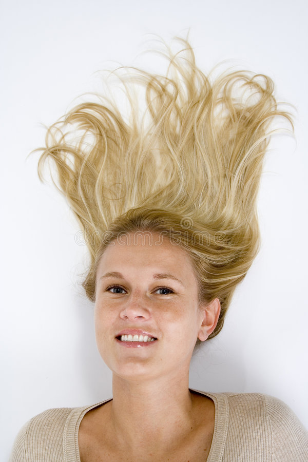 Beautiful Blonde Woman Casual Portrait Laying Down Hair Up stock photo