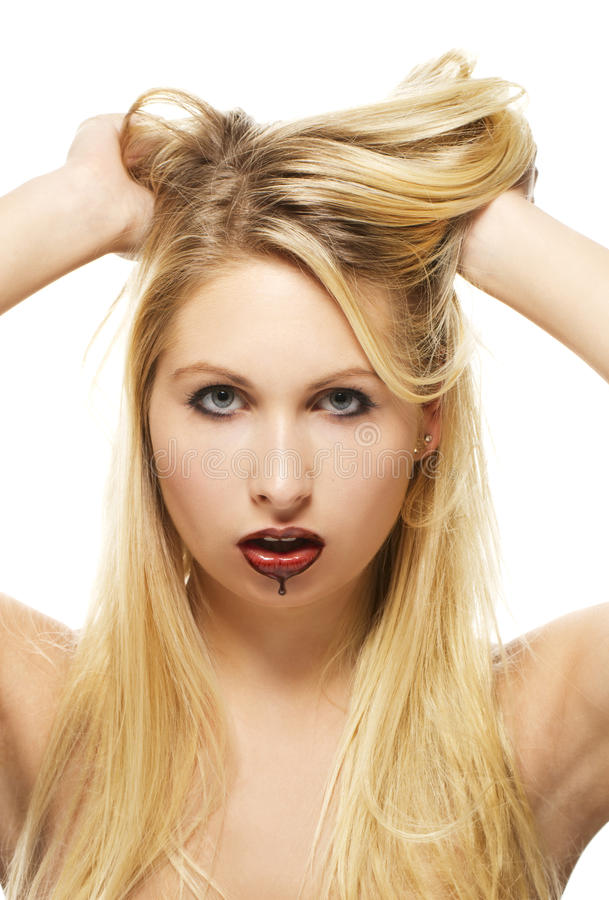 Beautiful blonde woman with chocolate covered lips royalty free stock image