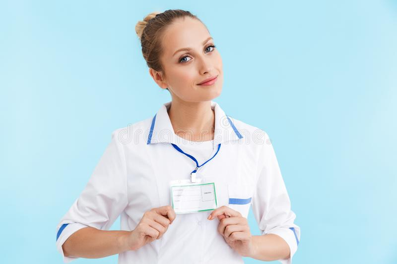 Beautiful blonde woman doctor wearing uniform standing royalty free stock photo