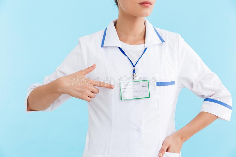 Beautiful blonde woman doctor wearing uniform standing royalty free stock photography