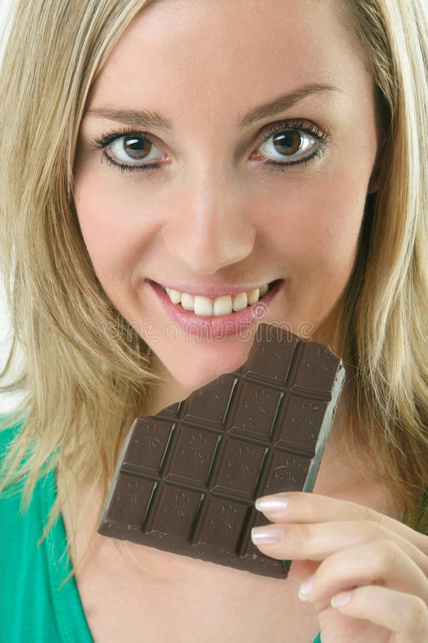 Beautiful blonde woman eating royalty free stock image