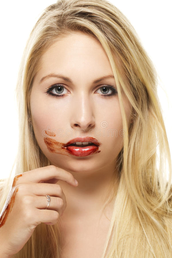 Beautiful blonde woman after eating chocolate royalty free stock photo